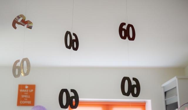 60 hanging sign